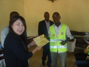 Minister for roads Makueni  County &  CORE CEO Yuka Iwamura giving out certificates to youths at makueni county